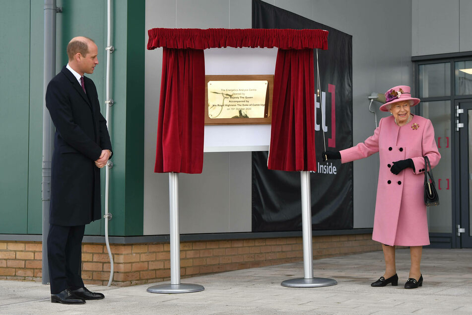 Prince William watches as Queen Elizabeth II unveils a plaque to officially open the new Energetics Analysis Centre at the Defence Science and Technology Laboratory.