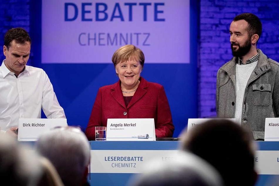 """120 Leser und Bürger kamen zur Diskussionsrunde in die gut abgeschottete Hartmannfabrik. Vier Chemnitzer diskutierten mit Merkel auf dem Podium. Torsten Kleditzsch, Chefredakteur der """"Freien Presse"""" führte durch die Gespräche."""