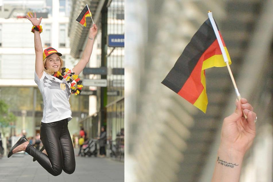 Die Dresdnerin Sarah (18) freut sich auf die WM - mit Trikot und bunten WM-Accessoires.
