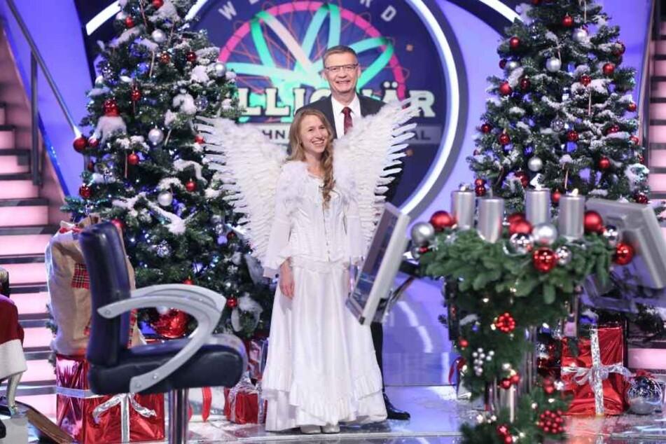 Moderator Günther Jauch mit Weihnachtsengel Angela Jehring.