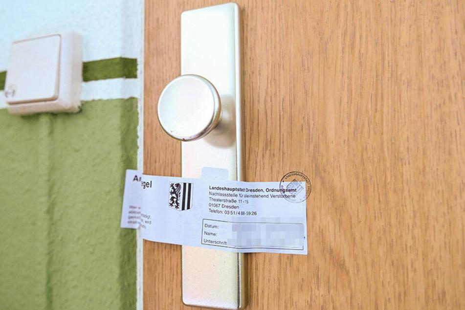 Am 9. Januar machte die Polizei hinter dieser Tür einen grausamen Fund. Nun ist die Wohnung versiegelt.