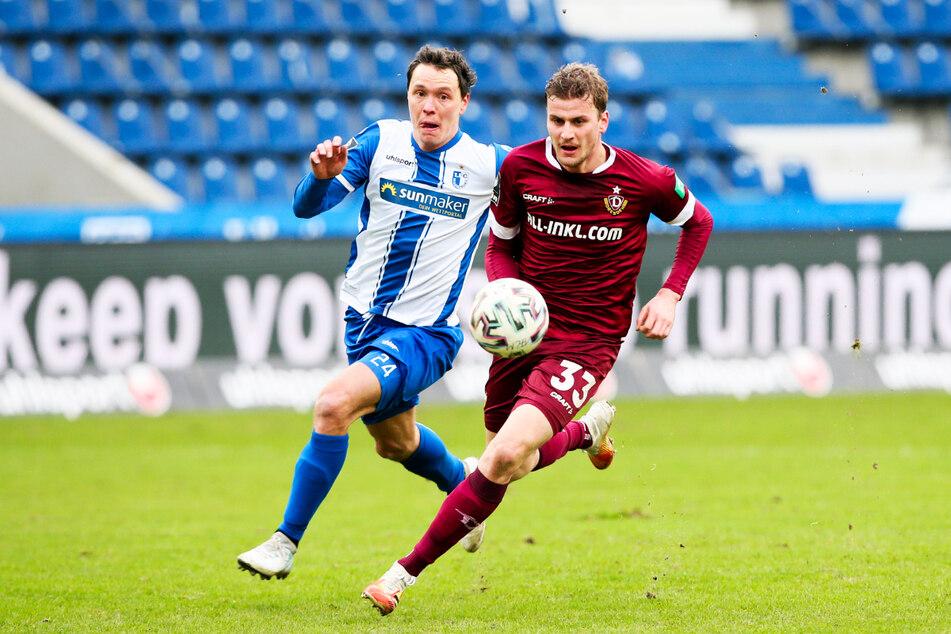Dynamo-Stürmer Christoph Daferner (r.) hatte gegen die FCM-Defensive um Alexander Bittroff einen schweren Stand.