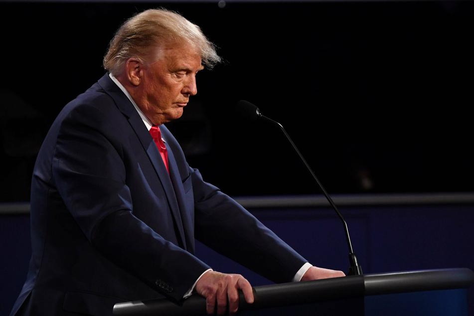 President Donald Trump listening to his opponent speak during the presidential debate.