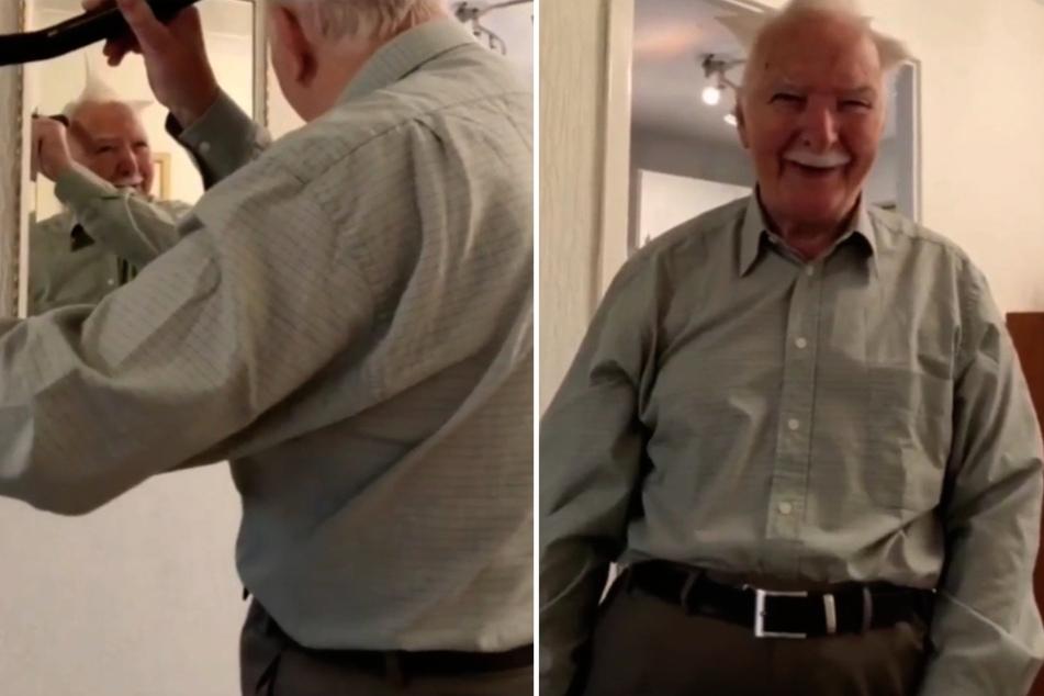Dieser Opa kann nicht aufhören zu lachen, als er der Kamera seine neue Frisur präsentiert.