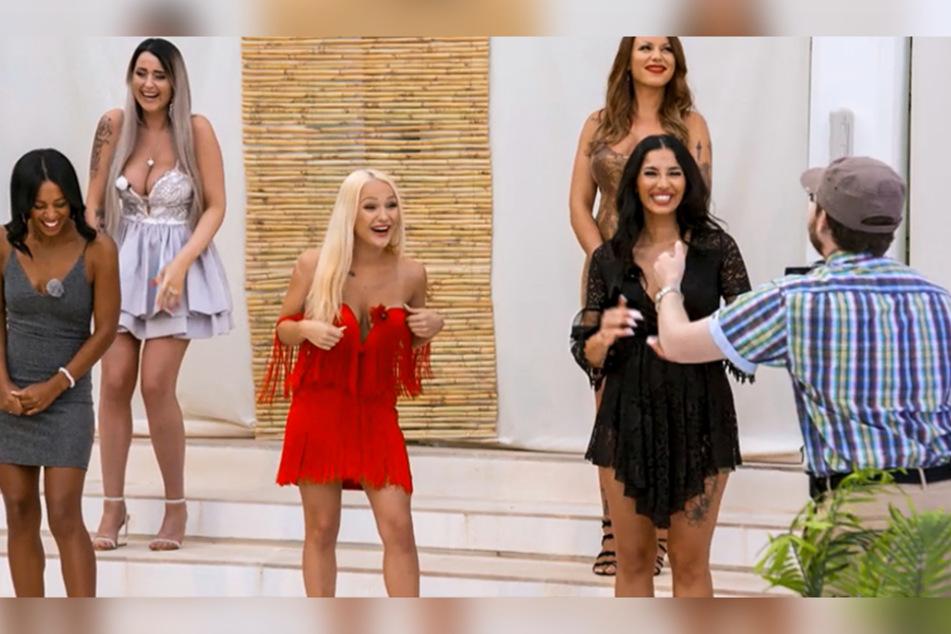 Emmy im roten Kleid erinnerte uns direkt an Katja Krasavice.