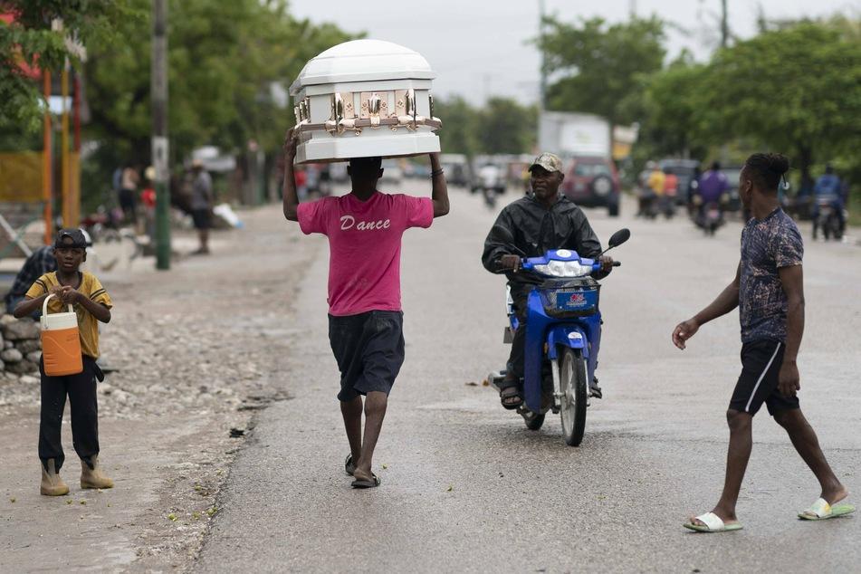 Haiti earthquake death toll climbs as tropical storm brings rains