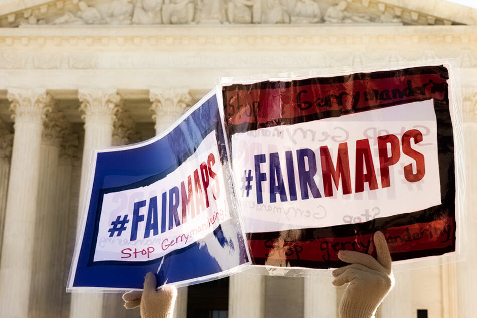 Protesters gathered to rally against the manipulation of district lines outside the US Supreme Court on March 26, 2019.