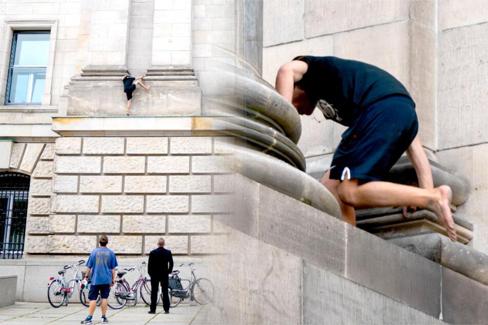 Berlin: Mann klettert Reichstagsgebäude hinauf!