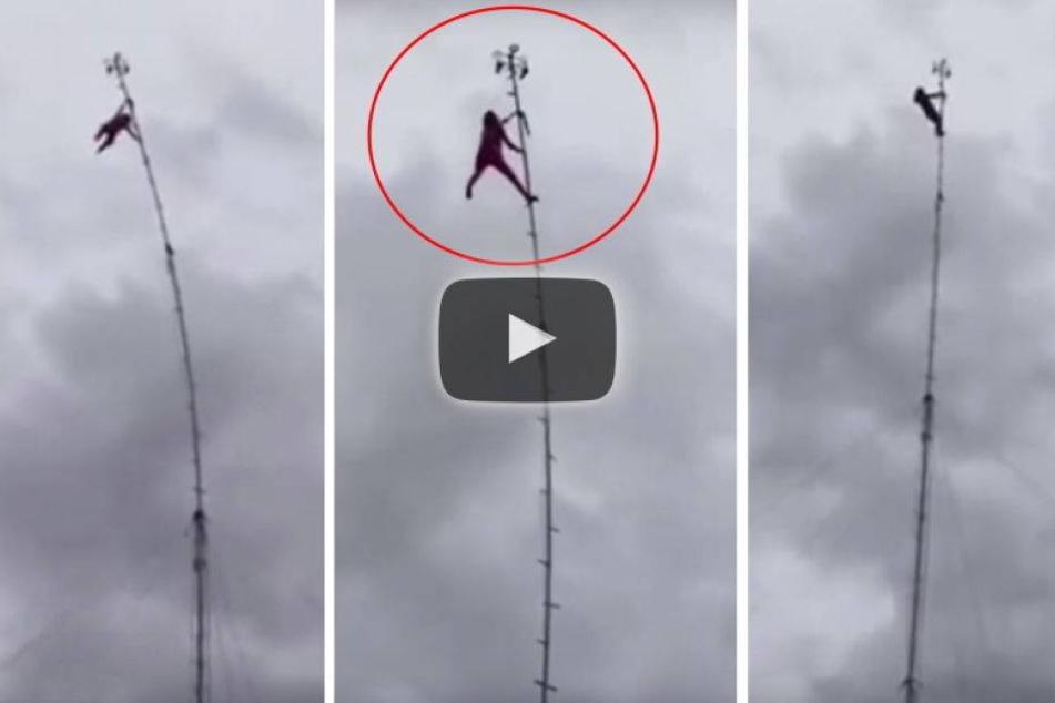 Was macht eine 80-Jährige auf diesem 30-Meter-Mast?