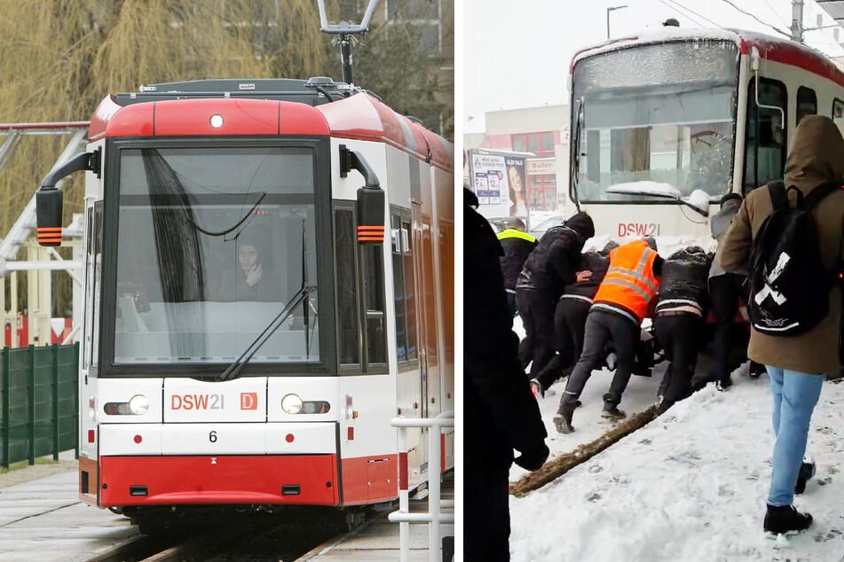 Straßenbahn im Schnee liegen geblieben: Passanten schieben Fahrzeug an!