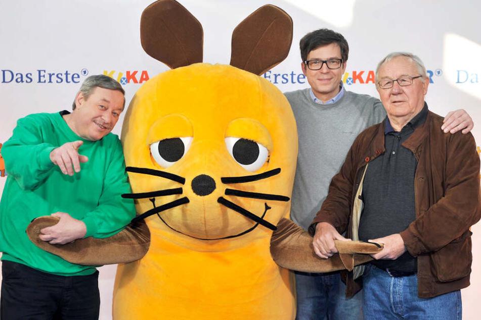Regisseur Christoph Biemann (l), die Maus, Moderator Ralph Caspers (M) und Regisseur Armin Maiwald (r).