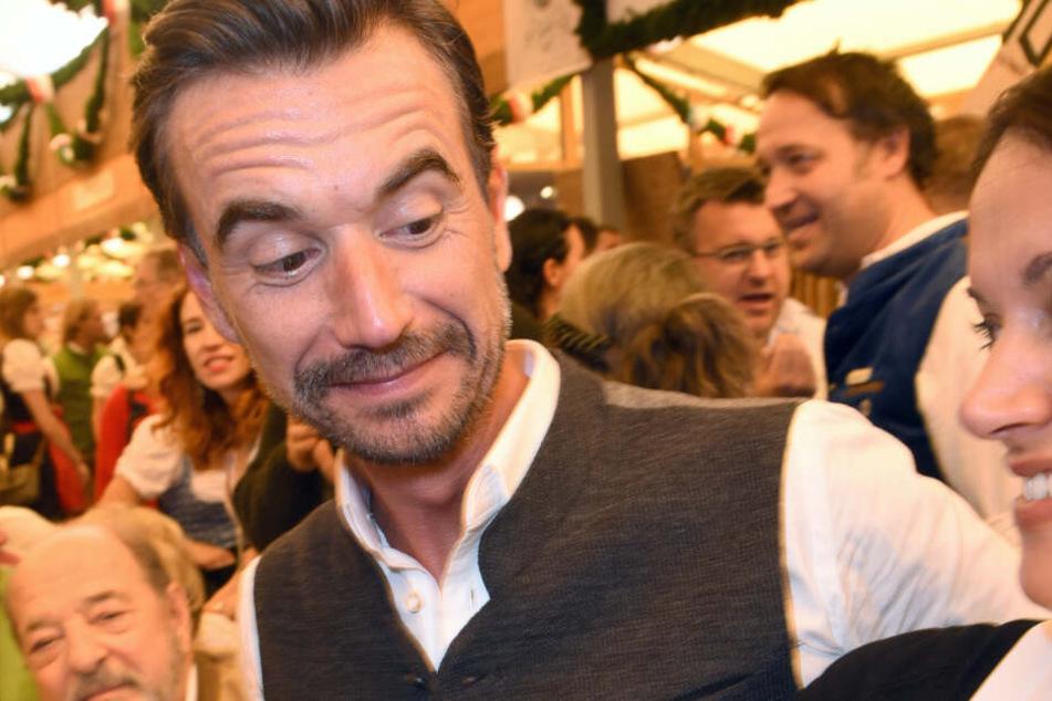 Der Moderator Florian Silbereisen feiert im Schottenhamel Festzelt auf dem Oktoberfest.