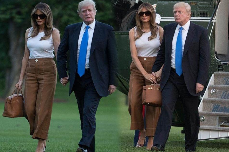 Melania und Donald Trump am 11.6.2017 in Washington. Ihre Tasche wollte Melania ganz offensichtlich selbst tragen.