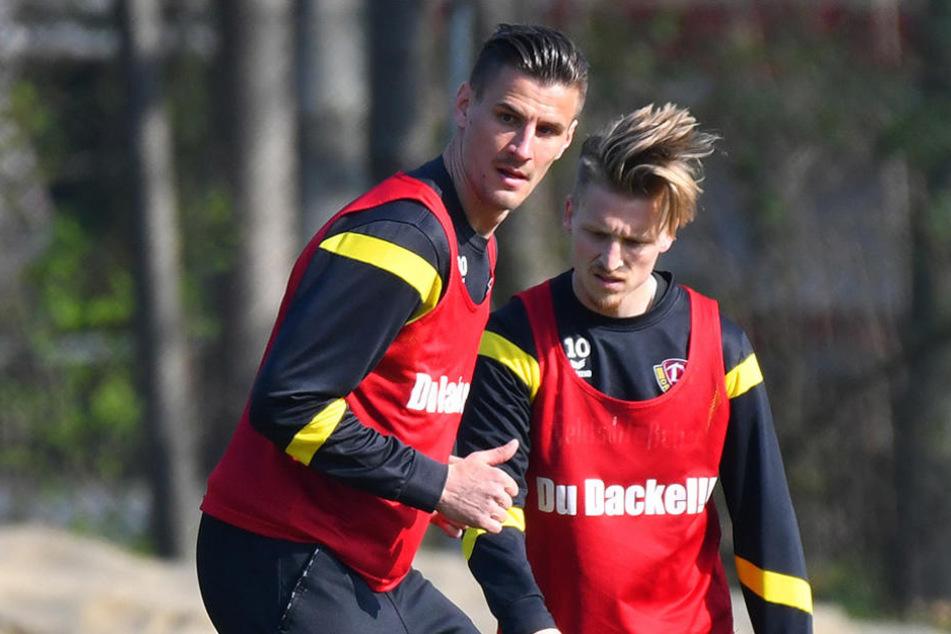 Stefan Kutschke (l.) sieht es realistisch, weiß aber auch: Alles ist möglich in der Liga.