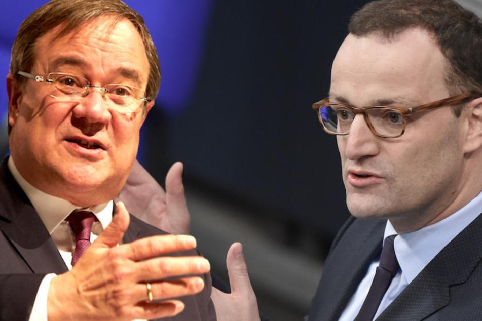 NRW-Landesvater Armin Laschet (57) rügte CDU-Kollege Jens Spahn (38) für dessen Haltung zum UN-Migrationspakt. (Bildmontage)