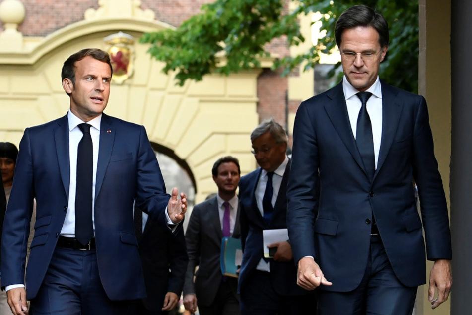 Den Haag: Emmanuel Macron (l), Präsident von Frankreich, trifft zu einem Arbeitsessen mit Mark Rutte, Premierminister der Niederlande, ein.