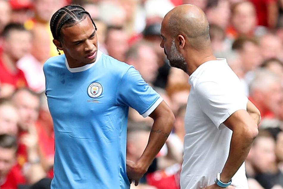 Leroy Sané (l.) will Manchester City offenbar unbedingt verlassen.