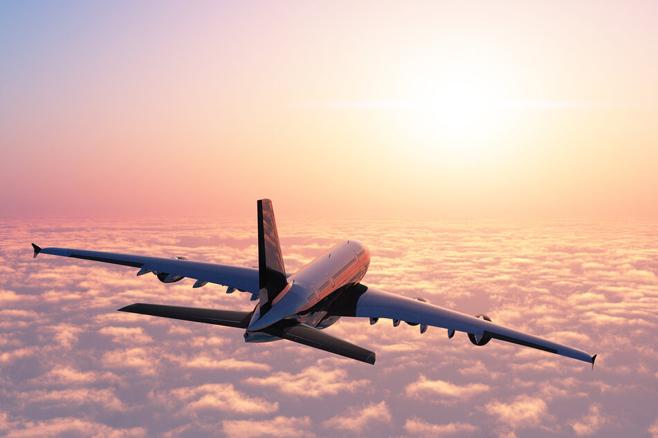 An aircraft above the clouds (stock image).