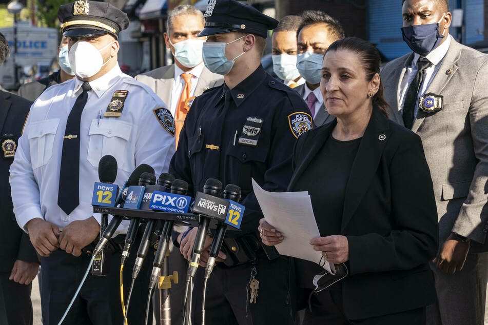 NYPD Deputy Inspector Jessica Corey (r.) debriefs the press on Burnette's arrest.