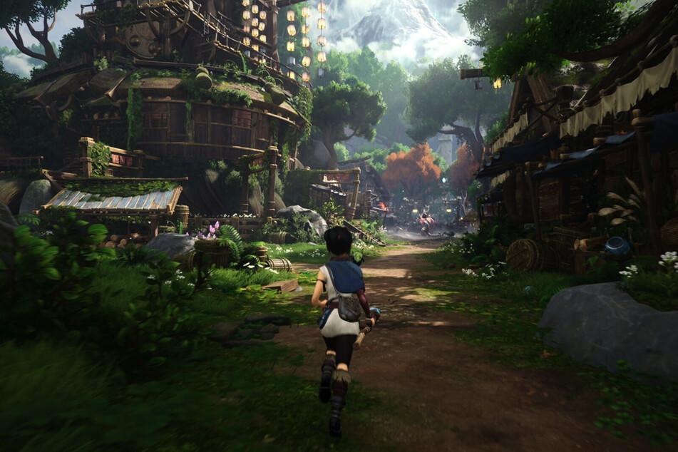 Unterwegs kommt Ihr unter anderem an diesem Dorf vorbei. Einige Gebiete sind dort erst später mit speziellen Masken zugänglich.