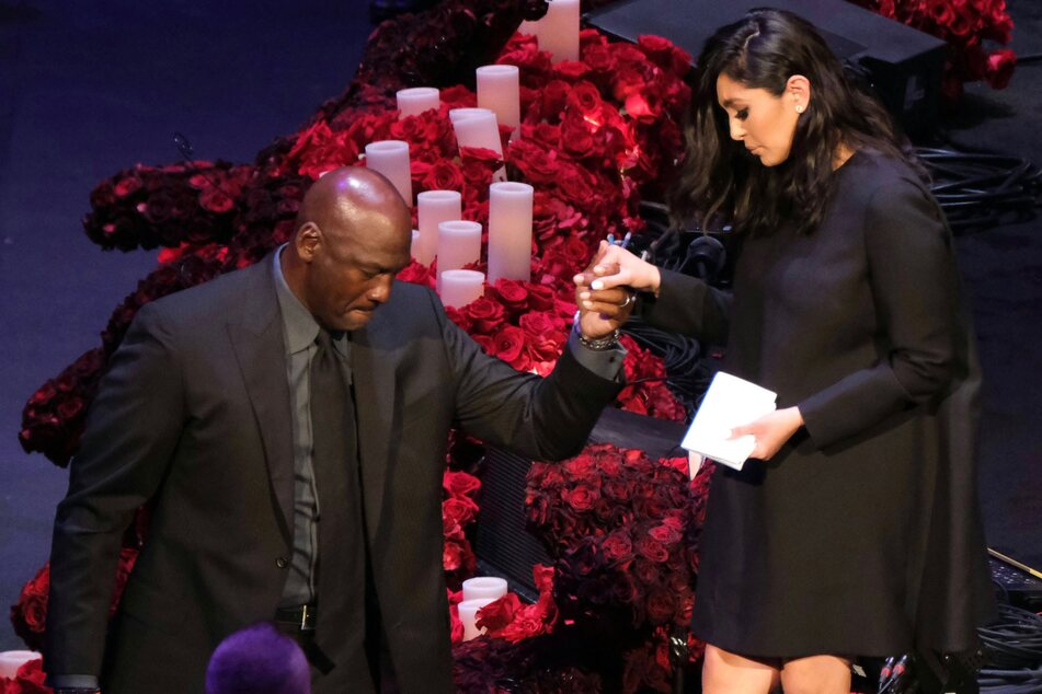 Vanessa Bryant is helped off the stage by Michael Jordan after speaking at a memorial service for her husband Kobe and daughter Gianna at the Staples Center in Los Angeles in February 2020.