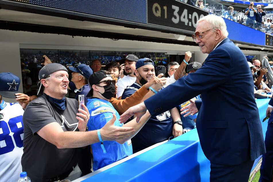 Cowboys owner and general manager Jerry Jones greets fans during a game in 2021.