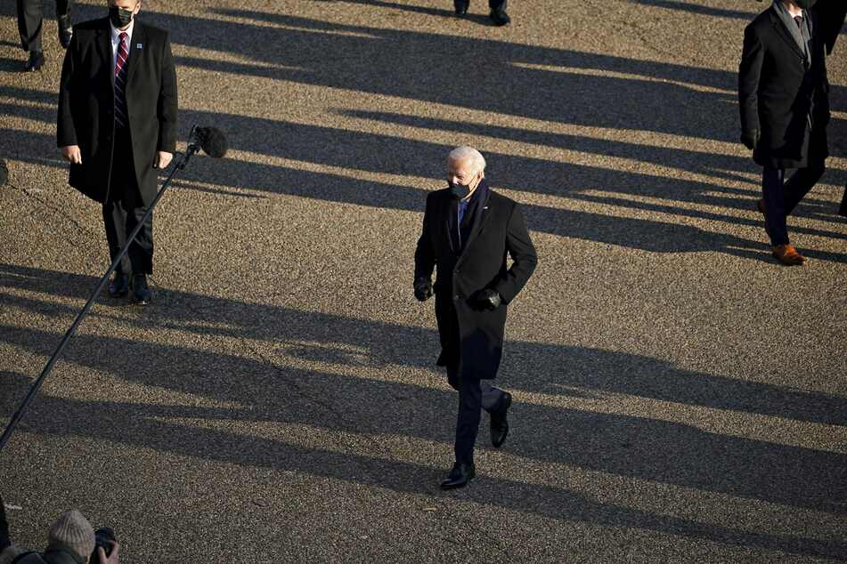 Biden often veered off-route to greet reporters and supporters lining Pennsylvania Avenue.