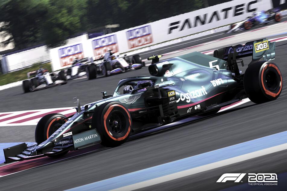 Sebastian Vettel heizt in seinem neuen Aston Martin um die Kurve.