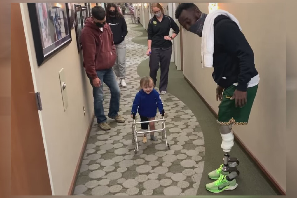 The video shows Blake Leeper (31) cheering Dyer on as he went on a first walk with his prosthetic leg.