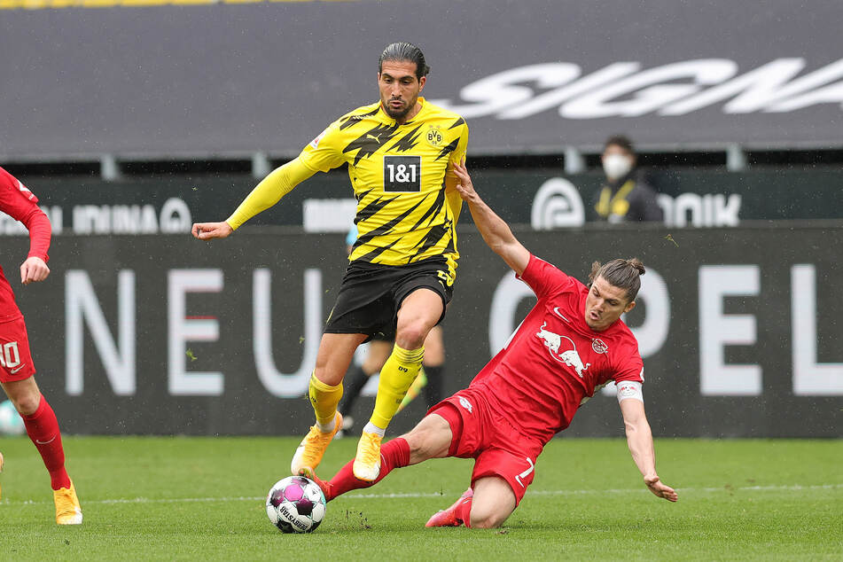 Borussia Dortmund's Emre Can (27) in a duel with RB Leipzig's Marcel Sabitzer (27).  The two will probably meet again on Thursday.