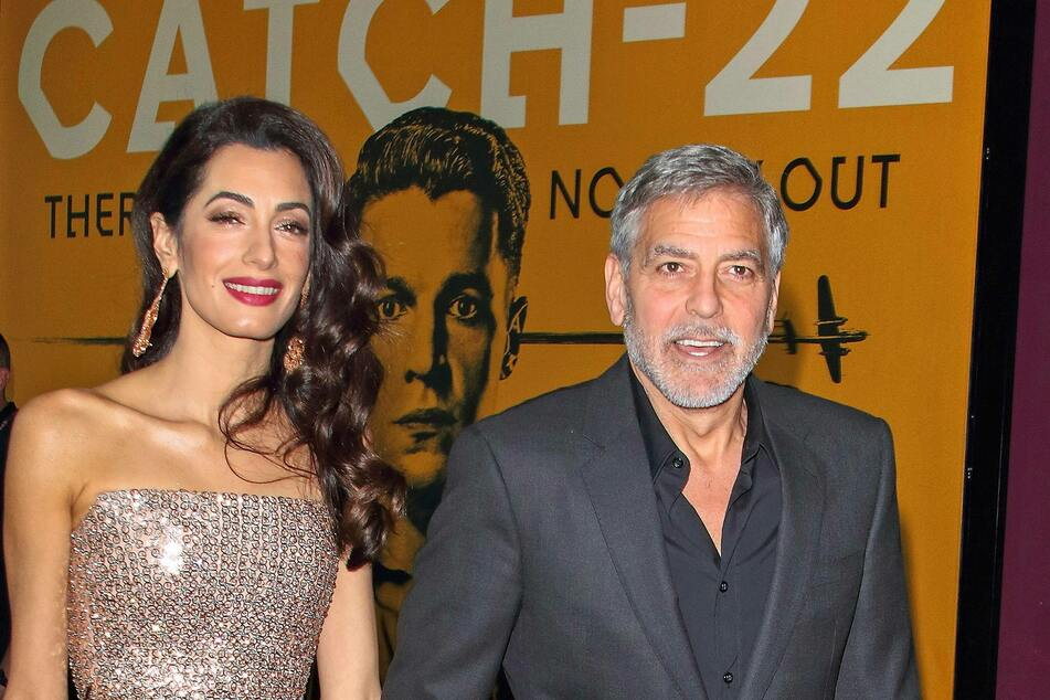 Amal Clooney with her husband George at the London premiere of the series Catch-22.