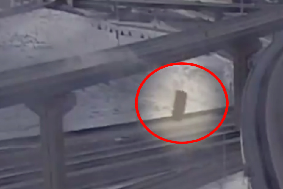 Shocking video shows pick-up driver losing control and plunging off overpass!