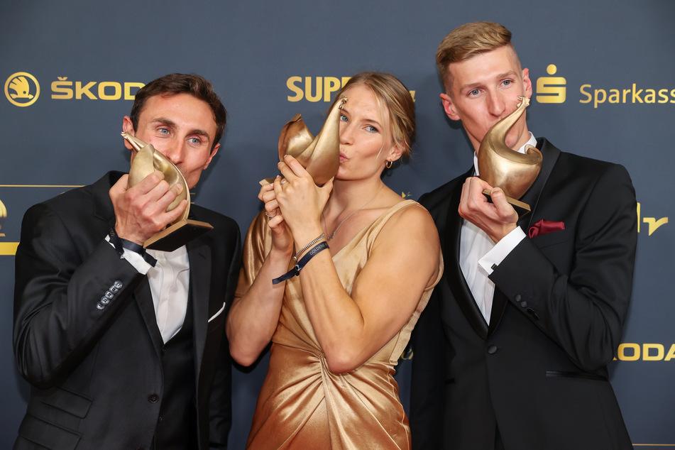 Als Olympia- und Paralympicssieger bekamen Triathlet Martin Schulz (31, l.) Ringerin Aline Rotter-Focken (30) und Schwimmer Florian Wellbrock (24) die Goldene Henne.