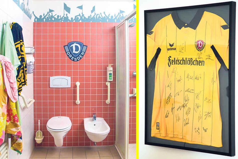 Auch das Bad ist mit Vereinswappen dynamisch eingerichtet. An der Wand hängt ein SGD-Trikot mit allen Unterschriften der Spieler.