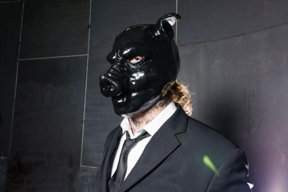 Mann mit Tiermaske (Symbolbild)
