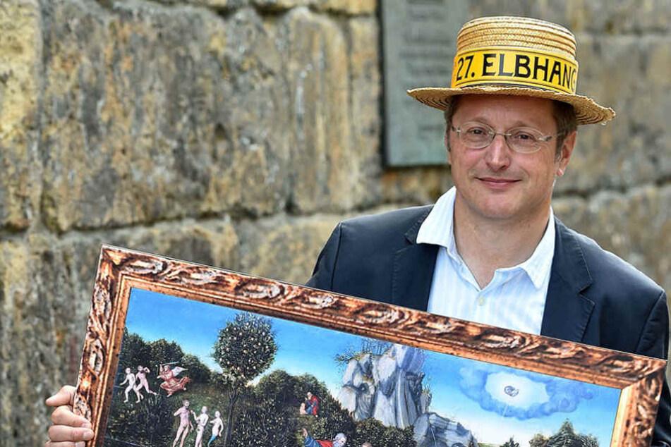 Holger Friebel (54) vom Elbhangfest-Verein mit einem paradiesischen  Bild des Pillnitzer Heckengartens.