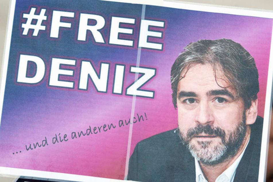 Das Foto zeigt eines der Plakate, die bei den Mahnwachen in Flörsheim gezeigt wurden.