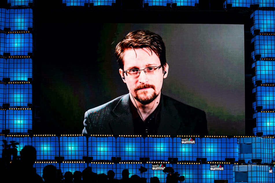 Edward Snowden speaks from Russia to the audience during the annual Web Summit technology conference in Lisbon in 2019.