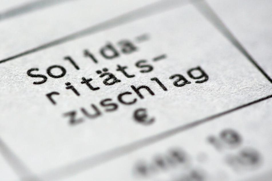Markus Söder fordert, den Solidaritätszuschlag vollständig abzubauen. (Symbolbild)