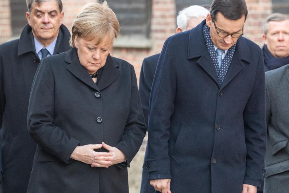 Bundeskanzlerin Merkel und Polens Ministerpräsident Morawiecki bei einer Gedenkveranstaltung in Auschwitz.
