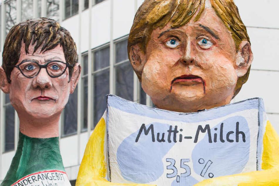 """Ein Motivwagen in Frankfurt mit einer Darstellung von Bundeskanzlerin Merkel (r) als """"Mutti-Milch"""" mit Verfallsdatum."""
