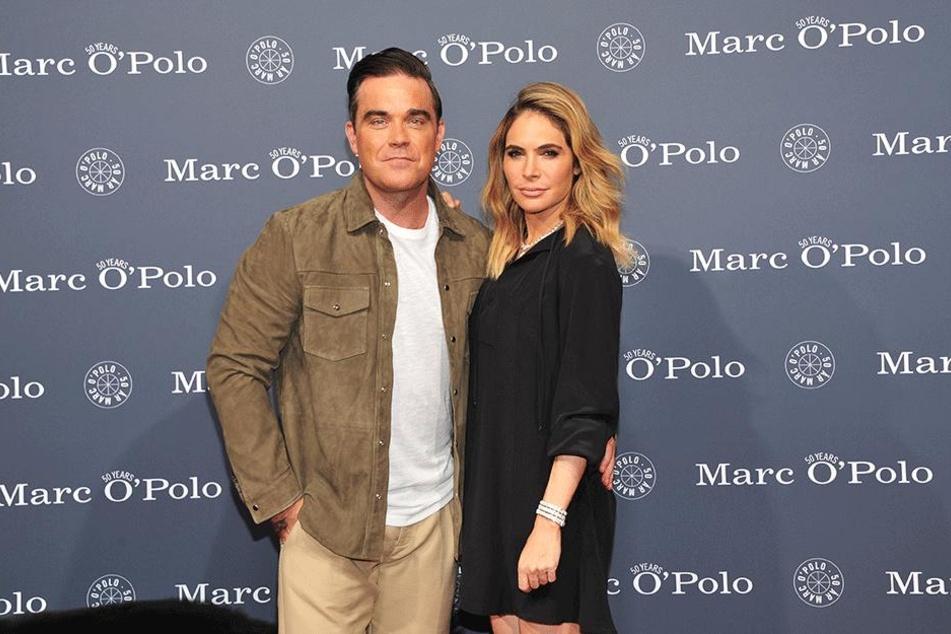 Der britische Popstar Robbie Williams und seine Frau Ayda Field Williams.