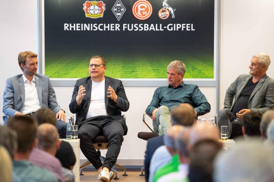 Simon Rolfes (l-r), Sportdirektor von Bayer Leverkusen, Max Eberl, Sportdirektor von Borussia Mönchengladbach, Friedhelm Funke, Trainer von Fortuna Düsseldorf, und Armin Veh, Geschäftsführer des 1. FC Köln
