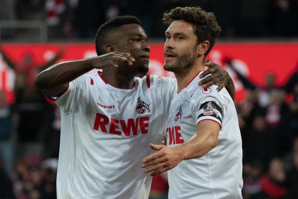 Die Kölner Torschützen Cordoba und Hector jubeln nach dem 3:0 (62.).