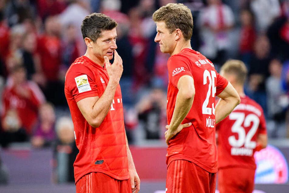 Betreten: Doppelpacker Robert Lewandowski (l.) und Thomas Müller waren nach dem 2:2 gegen Hertha BSC nicht zufrieden.