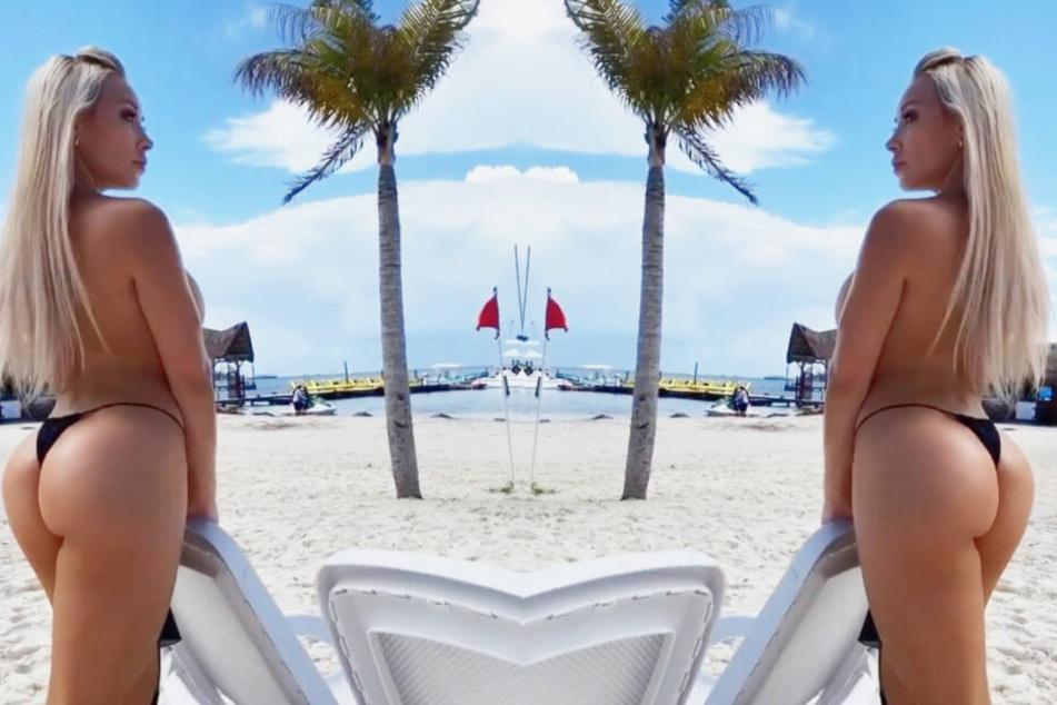 Playboy-Model macht sich am Strand nackig, zu sehen gibt's trotzdem nichts!