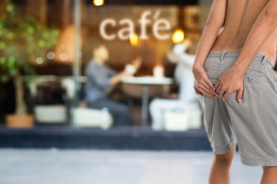 Total eklig: Mann kackt mitten am Tag vor voll besetztes Café