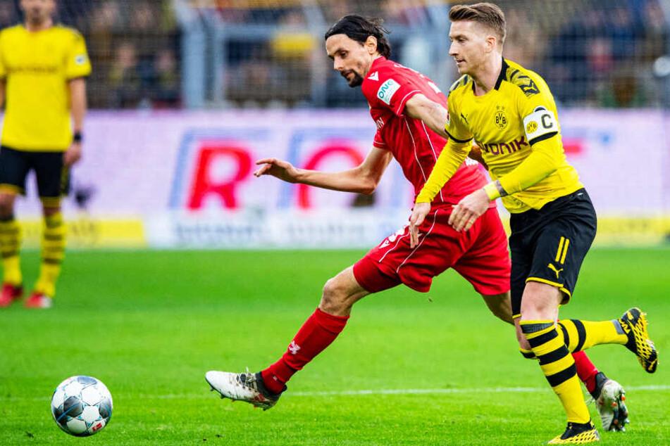 Marco Reus war unzufrieden, dass er vorzeitig ausgewechselt wurde. Hier duelliert er sich mit Ex-BVB-Profi Neven Subotic.