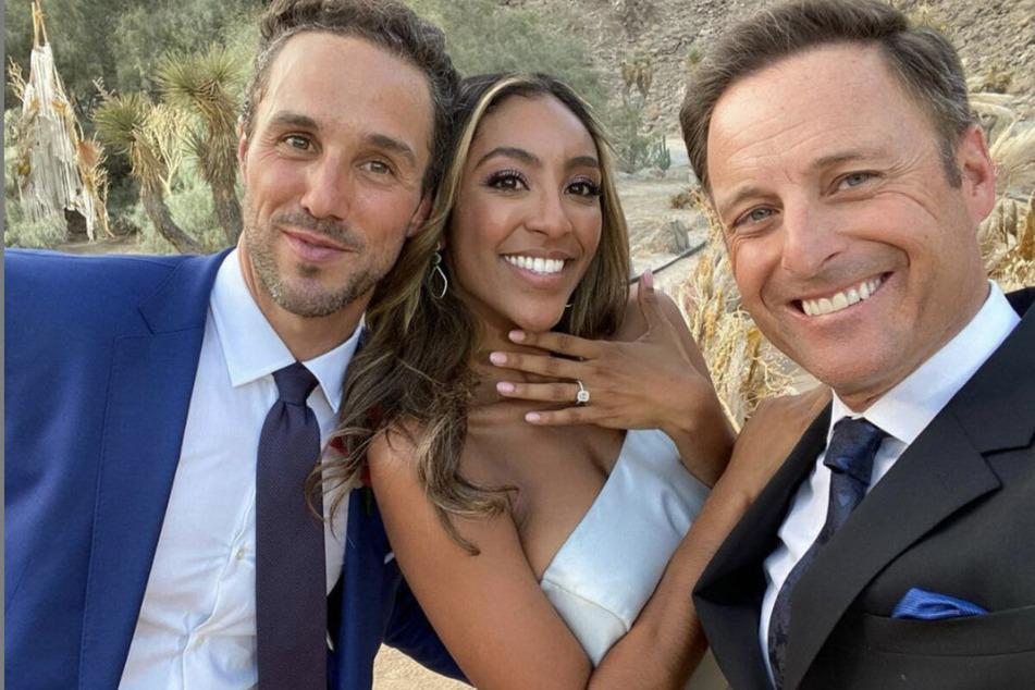 Chris Harrison (r.) poses with Tayshia Adams (c.) and her fiancé Zac Clark on Season 16 of The Bachelorette.
