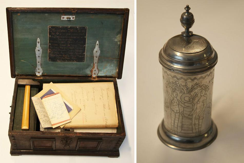 Diese Zunfttruhe (l.) aus dem Jahr 1744 und ein Bierkrug wurden von den Tätern mitgenommen